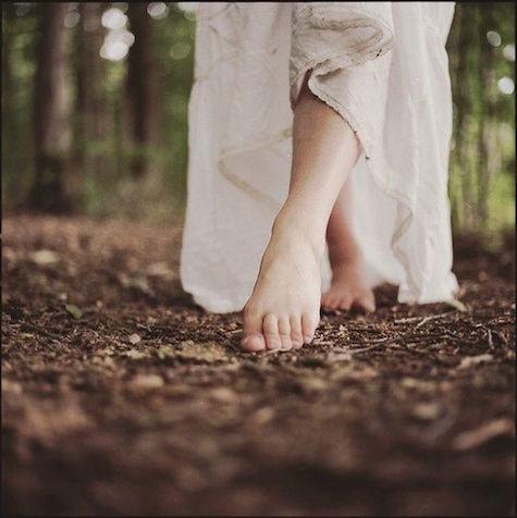 Feet walking in the dirt